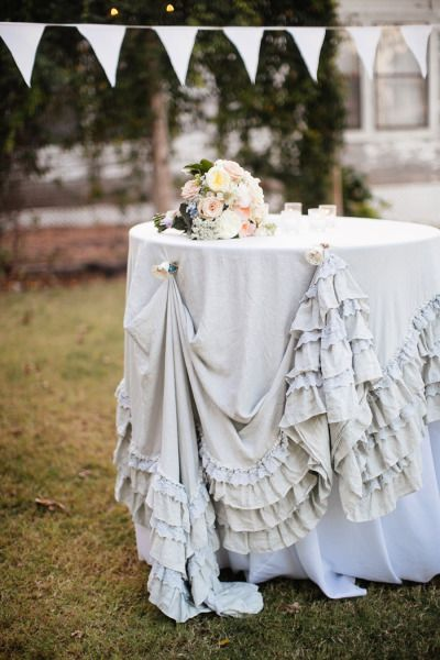 Vintage chic ruffled tablecloth: http://www.stylemepretty.com/texas-weddings/2014/12/01/shabby-chic-texas-wedding-at-the-prairie/ | Photography: Anne Marie - http://annemariephotography.com/