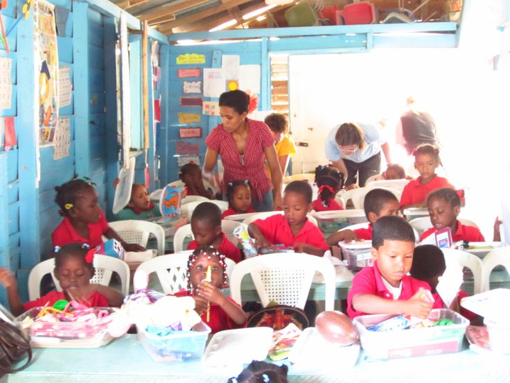 handing out shoeboxes to the schoolchildren