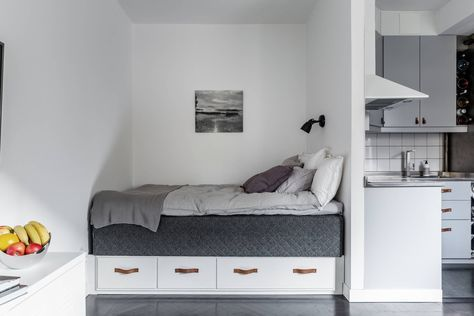 Compact studio apartment with monochromatic decor. Are you looking for unique and beautiful art photos or poster prints (not the ones featured in this pin) to create your gallery walls? Visit bx3foto.etsy.com and follow us on IG @bx3foto #decor #interiordesign #gallerywall #artwall #photoprints #artphotos #finephotography #posters #bx3foto