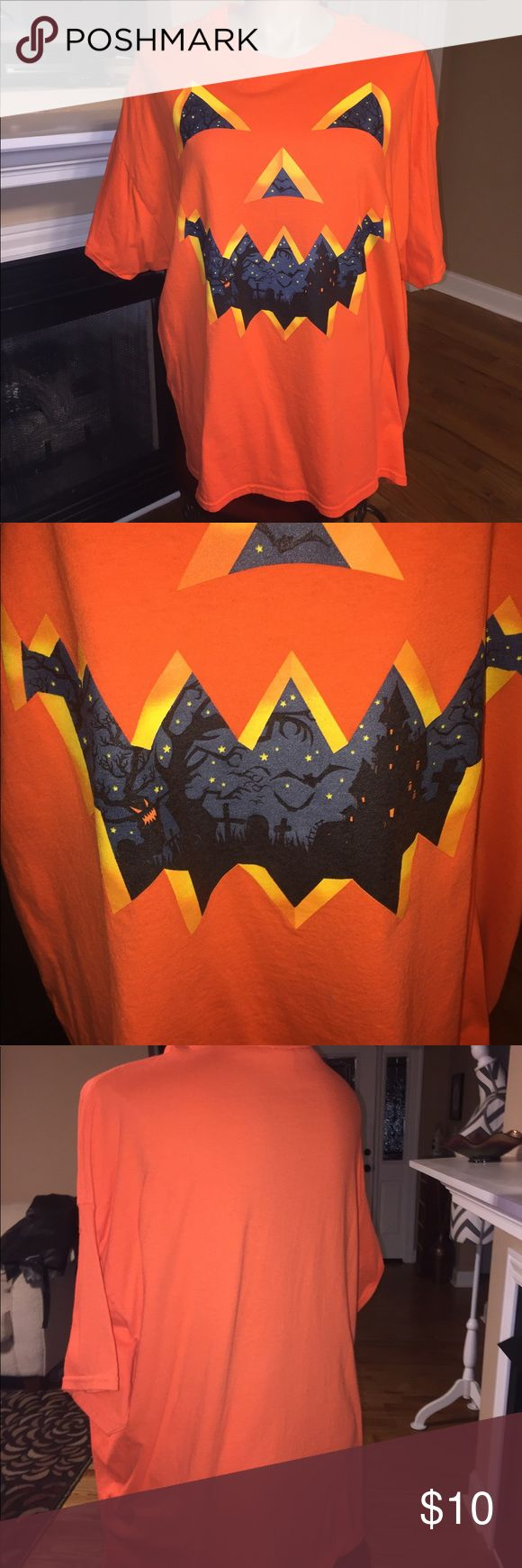 Halloween tshirt Super festive tshirt. Scary pumpkin with haunted house pictures in the face. Tops