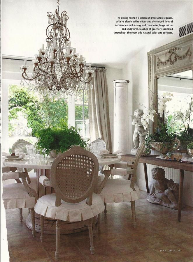 I love the soft colors and fabric of this dining room, the chandelier, the ruffled chair covers......  I want it all!!!!