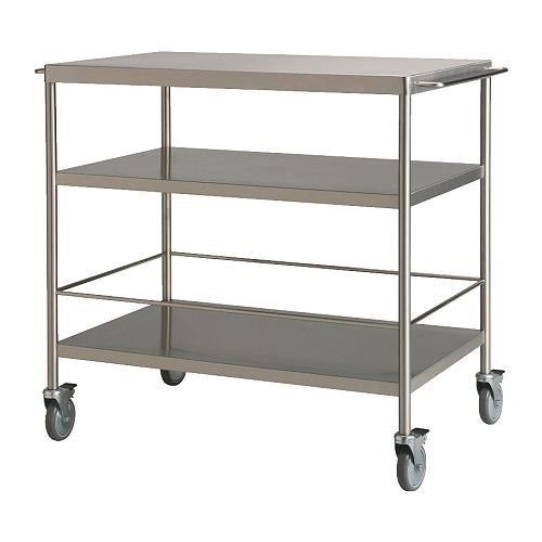 Ikea FLYTTA Kitchen cart $159.00. I could put some metal shelves above this to look like one shelving unit.