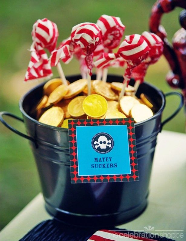 Pirate Party..metal bucket with gold coins (chocolate wrapped in gold foil) and red and white stripped bandanna pops.
