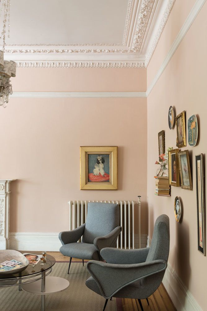 Farrow and Ball's Setting Plaster, pink paint walls with white details is an easy way to decorate a living room from www.redonline.co.uk