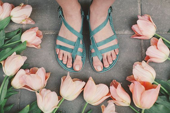 Soft, sky-blue leather sandals are made for summer days.