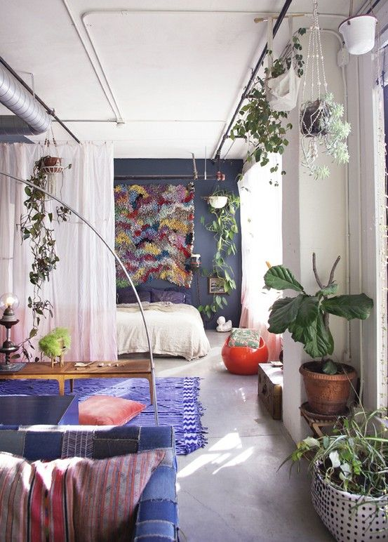 i love the idea of the pole along the ceiling to hang plants and whatnot from. how clever