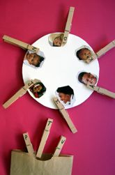 "'Initial Sounds Match-Up' - stick photos of family or class members onto a circular piece of card. Match initial soundw written on the pegs to the person whose name begins with that letter ("",)"