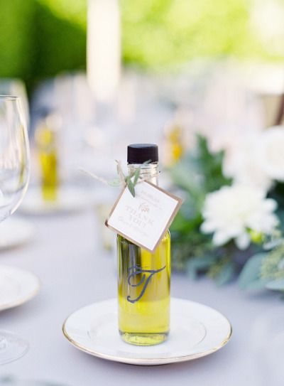 Olive oil favors: http://www.stylemepretty.com/2014/10/13/elegant-garden-wedding-at-a-montecito-estate/   Photography: Élan Klein - http://elankleinphoto.com/