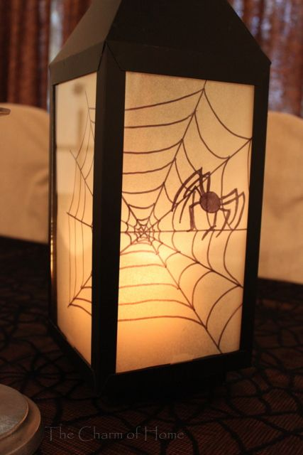 The Charm of Home: Spider Silhouette Lantern