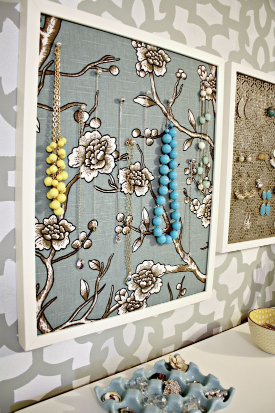 What a great idea for necklace storage - get a lovely frame, put some foam or even cork board inside and cover it with some nice material - hang on the wall and then use pins to hand necklaces - not only looks nice, but reminds you of which necklaces you've got - might wear them more often that way!