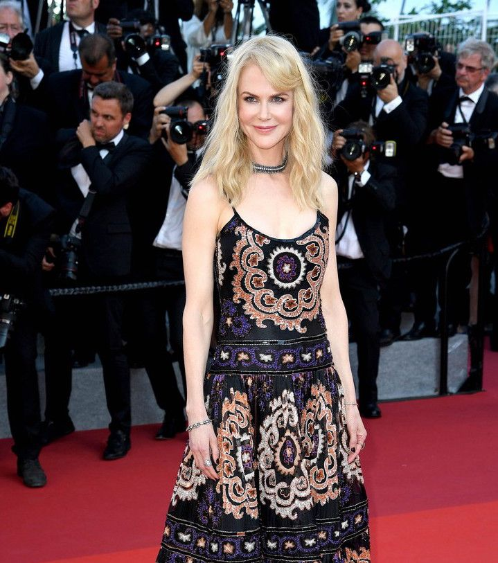 Nicole Kidman wore a heavily beaded, boho-inspired Armani Privé couture gown with a collection of vintage diamond jewels by Stephen Russell of New York. For glamour celebrity fashion Cannes Film Festival red carpet jewellery spotting travel here: http://www.thejewelleryeditor.com/jewellery/top-5/cannes-2017-red-carpet-jewellery-70th-anniversary-party/ #jewelry