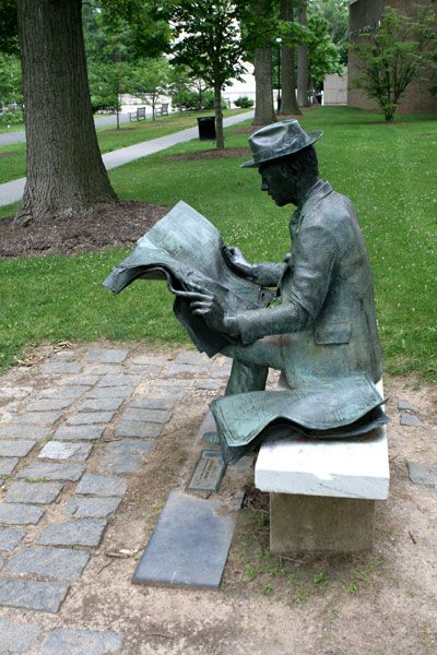 'The Newspaper Reader' by J. Seward Johnson (1975) - Princeton, NJ;  The bronze man reads 'The New York Times' on a park bench among the trees in Princeton's Borough Park. This is one of several casts of the sculpture, some of which are reading other newspapers.