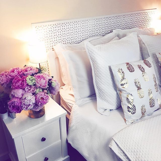 Finally got my dream bedroom put together with a white bed frame and a million cushions and pillows  And HELLO to the most beautiful Peonies I've ever had! Peonies from @arena_flowers (use itf20off for 20% discount), Bed and bedside tables from @nextofficial, lamp from @thewhitecompany, all bedding and white cushions from @christy_home and gold cushions from @hm  #home #Homewear
