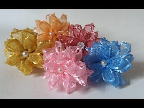 В этом видео уроке я покажу как сделать красивый цветок из лепестков Канзаши. Приятного просмотра и Творческого вдохновения. Если вам понравился урок, подели...