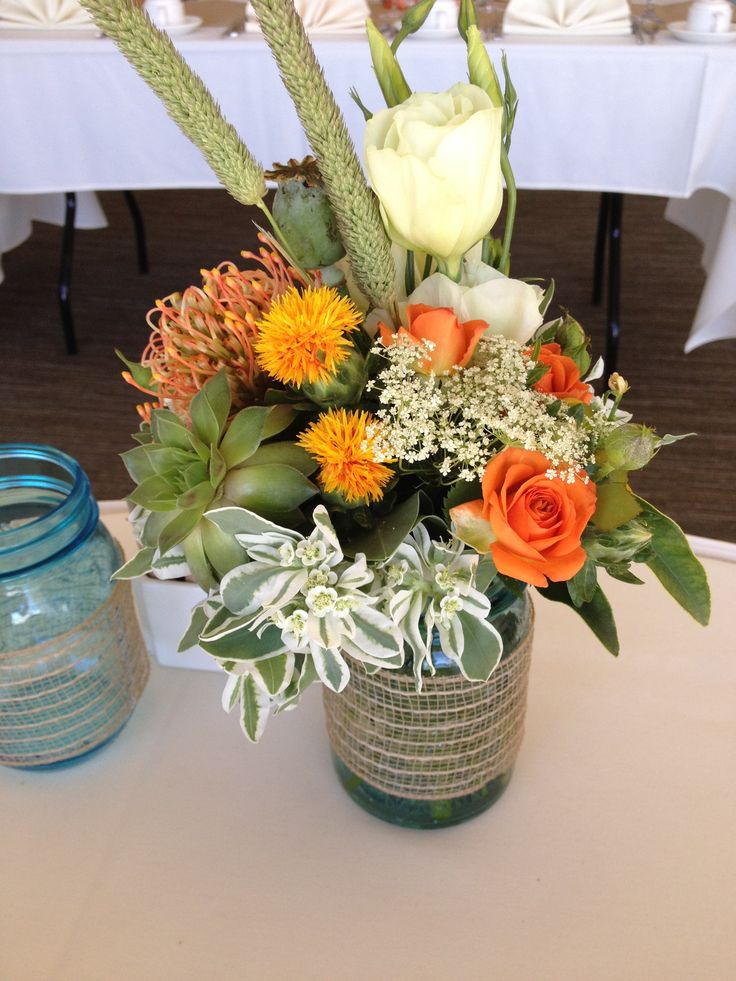 Small Centerpieces w succulents and orange accents
