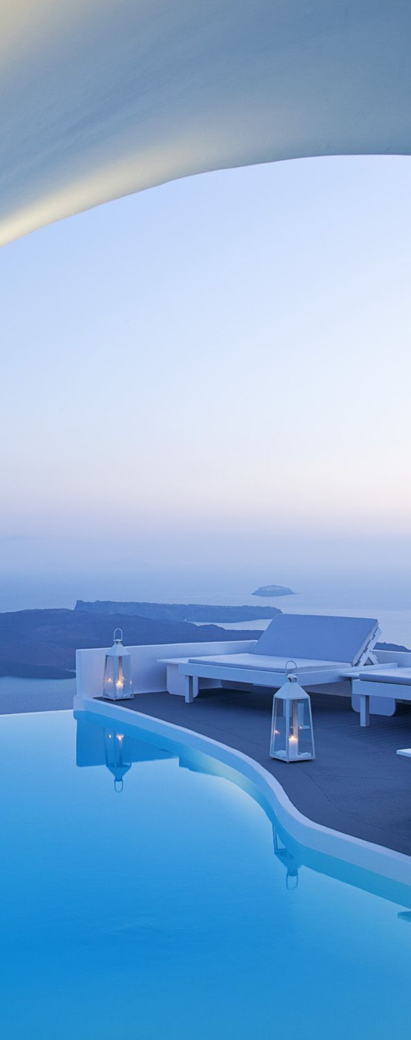 Volcano views from the Chromate Santorini and gorgeous ocean views. Iconic Greek islands.