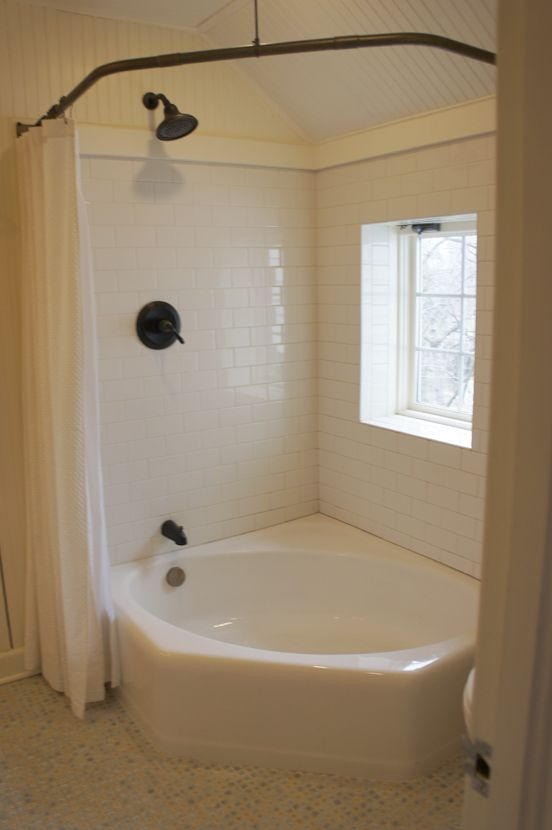 love the combo jetted tub and shower idea double curtains and bronzed bar make it