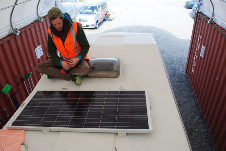 Our team at work, new rims and solar panels for our fleet.