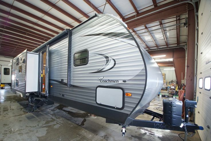 """FEEL LIKE YOU'VE NEVER LEFT HOME!!!  2017 Coachmen Catalina Legacy Edition 293RLDS This charming 33'9"""" long 7,530 lb. RV is the perfect home away from home! Take residential elegance with you with features like a toasty fireplace, free-standing dinette, and a lovely kitchen island! The 293RLDS also features a pleasant starlight system, with pleasing LED lighting that gives off a pleasant glow! Give our Catalina Legacy Edition expert Chip McCue a call 616-260-0278 for pricing and info."""