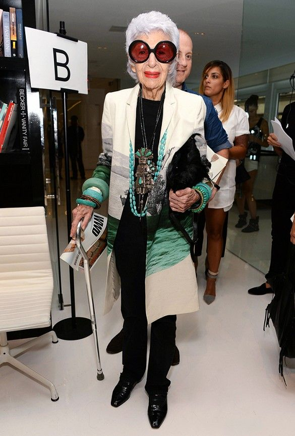 Iris Apfel, queen of eclectic in turquoise jewelry and her signature oversized round-frame sunglasses