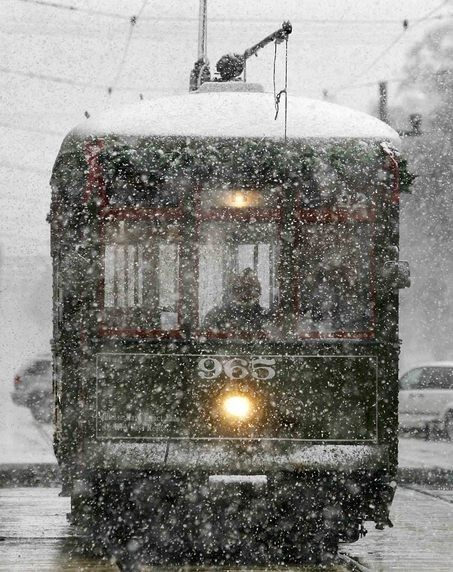 tram in snow - this makes me chilled and looking forward to sitting by a warm fire.