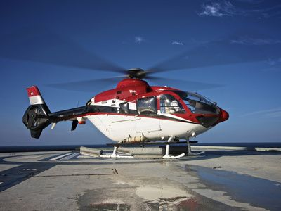 Eurocopter EC135 Utility Helicopter On the Helipad of An Oil Rig