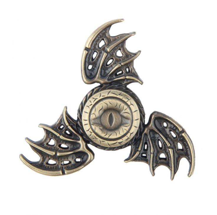 Hand Spinner 3 branches avec des ailes de dragon et un oeil malveillant à la place du roulement central. Ce bel hand spinner en laiton Game Of Thrones.