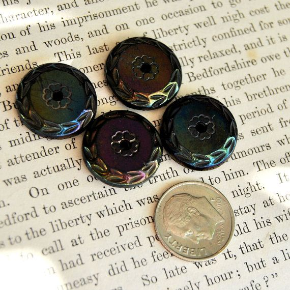 Gorgeous set of antique black glass buttons with iridescent luster.  Whistle shank  Late 1800s.    Dimensions:  3/4 (17mm) diameter    Quantity: 4      Buttons come to you in as-found state. Purchasers can expect to encounter light dust and dirt.    Shipping charge includes postage, delivery confirmation and insurance where not cost prohibitive by country. More Glass buttons…