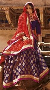 Designer Rajasthani Bandhej Saree for a royal look. Exclusive purple and red premium fabric half and half Rajasthani saree which is finished with the fine work of with lace and printed. Matching blouse piece attached with this attire.The blouse of this bandhani designer saree can be stitched in the maximum bust size of 42 inches...