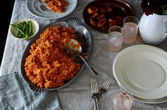 """Because Jollof Rice is Bae, and much loved South of the Sahara and along the coast of West Africa. Spiced and stewed in a flavorful tomato broth, it is everything from """"everyday"""" to celebration. The classic version is cooked with long-grain rice (Uncle Ben's/Carolina's) and seasoned with curry powder and dried thyme. Served with fried plantains and coleslaw, it is everything. Note that the world might consider this a side but in Nigeria, it is the main. :) Even more s..."""