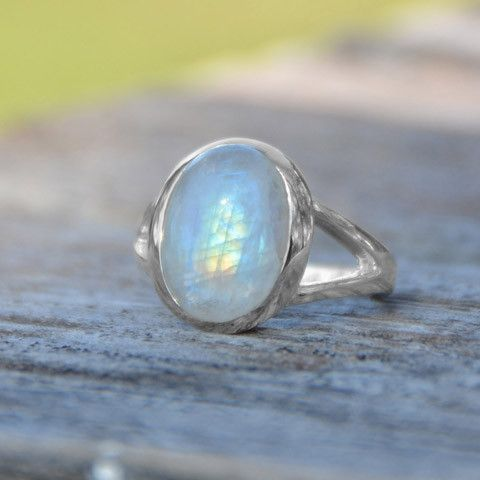 .925 Sterling Silver split shank ring with a genuine oval rainbow moonstone gemstone. The moonstone measure approx. 15.5mm x 12mm. Metal Material: .925 Sterling Silver