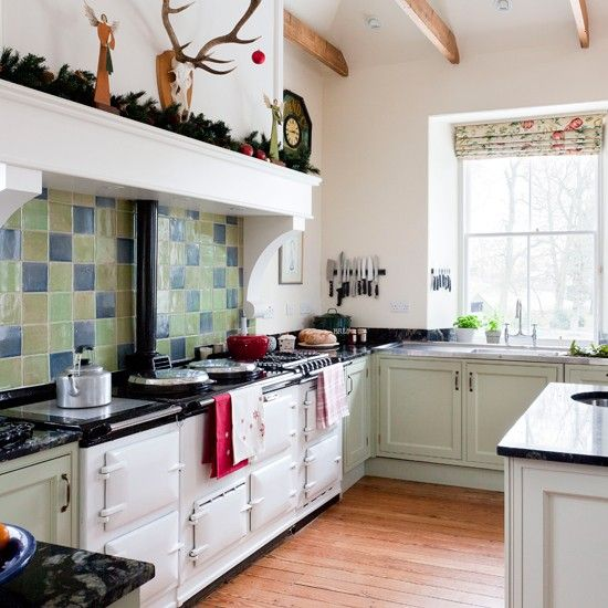 Traditional green kitchen with range cooker  A colourful green and blue splashback looks striking against a range cooker and classic cabinetry in this traditional kitchen.  Range cooker  Aga  Kitchen cabinetry  David L Douglas  Find more traditional kitchens in our inspiration-packed kitchen channel.  Follow us onFacebookandTwitterfor the latest homes and interiors trends, news and competitions.