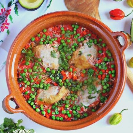 Arroz con Pollo The Clay Cooking Pot is from Ancient Cookware   When you smell the aromas of a rice stew with chicken (Arroz con Pollo) cooking in a clay pot, your mind wanders to a distant place, like a kitchen on a farm where a grandmother is cooking just for you. The juices that...Read More