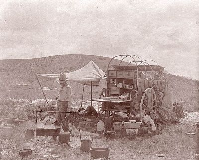 This is a old photo of a cowboy cook with his chuck wagon. The image was captured in 1907 on a Texas Ranch. If you have ever had the chance to eat real cowboy cooking, it is really good. Cowboy food is not about living long, but living large. A chuck wagon like this one would likely be cooking up buttermilk biscuits prepared in a dutch oven on a campfire, beef, lamb, and goat slow cooked over oak coals, hard cured hams, pinto beans, cowboy coffee and even peach cobbler. (lots of salt and…