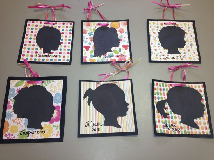 Gift for parents- silhouettes! Take a side profile picture of each child, print them out and cut them with black construction paper/card stock behind the photo! So much easier than trying to have the little ones hold still while you trace their shadow!