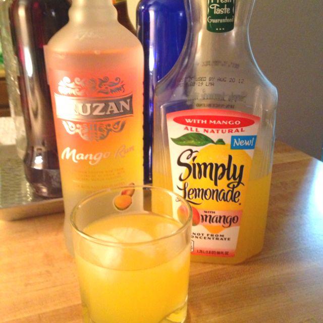 New favorite summer drink. Cruzan mango rum + Simply lemonade with mango. @cruzanrum