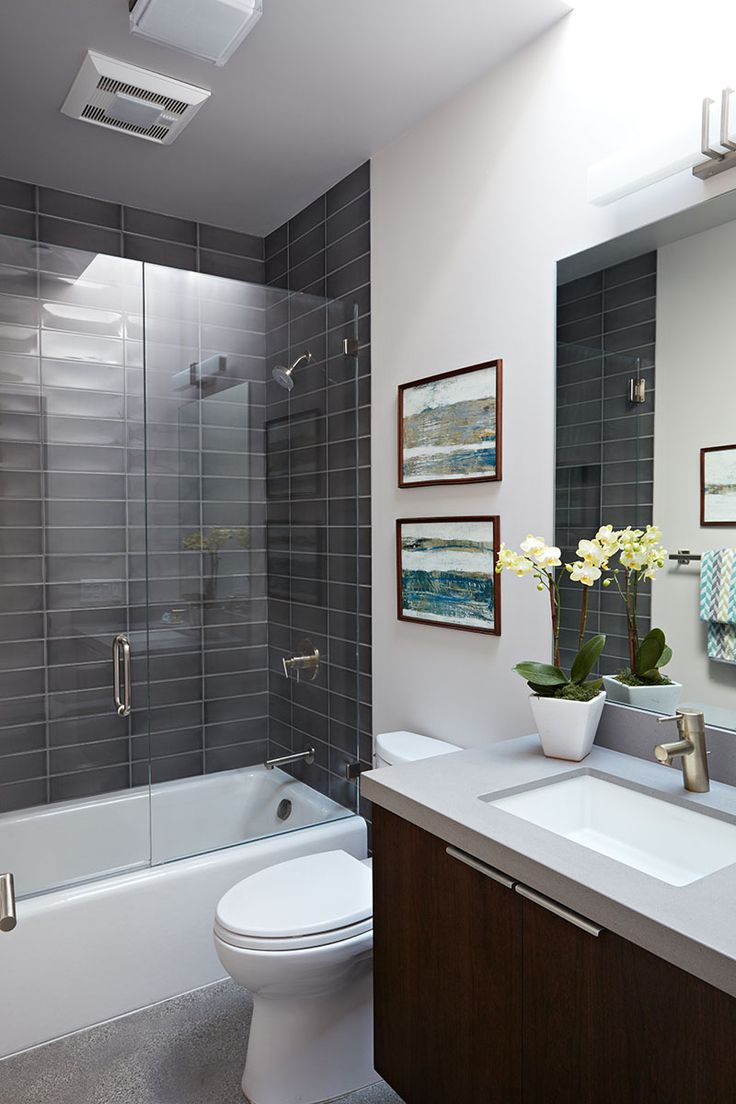 Grey subway tiles have been used for this bathtub and shower surround.