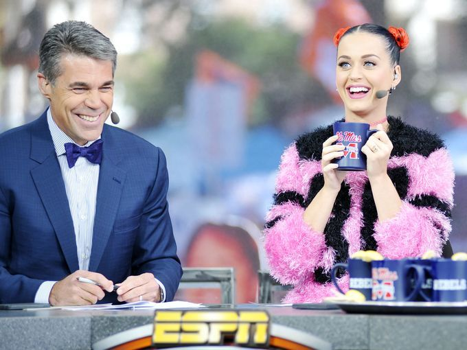 Singer Katy Perry, right, joins host Chris Fowler,