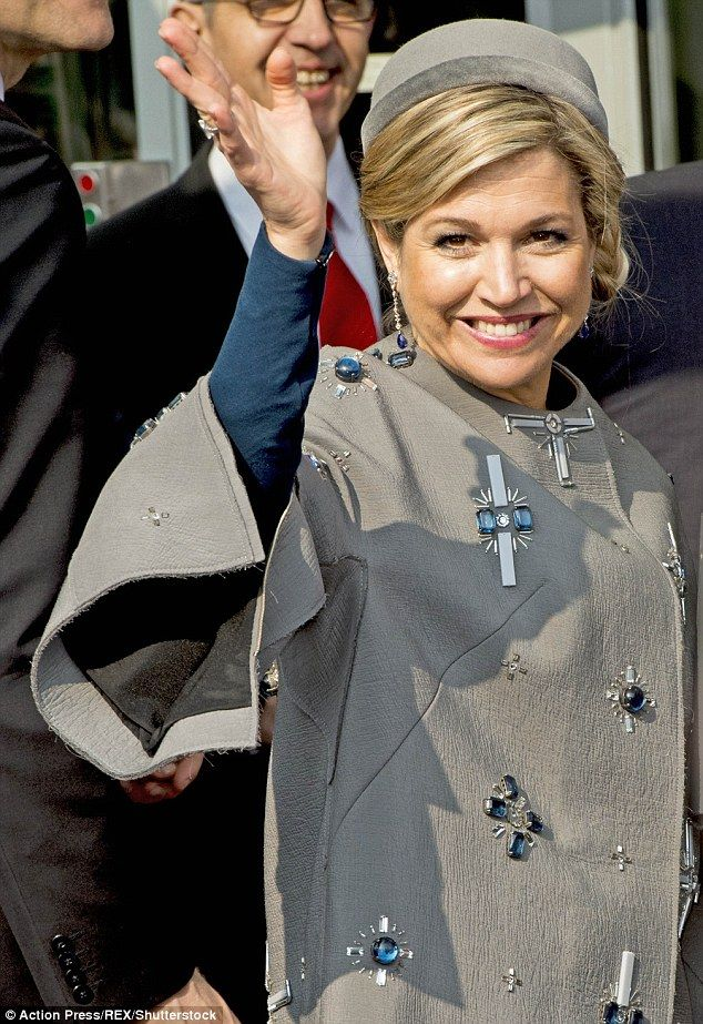 Queen Máxima of the Netherlands, 44 caused a stir during a state visit to Germany yesterday when she wore a Claes Iversen coat with beading detail that some onlookers compared to the swastika
