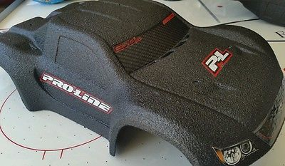 A Traxxas Slash Pro-Line body sprayed with bed liner.