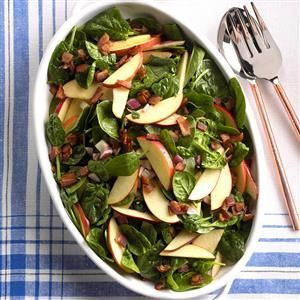Hot Spinach Apple Salad Recipe -This salad is just lightly coated in a sweet-tangy dressing so the spinach doesn't wilt and the apples retain their crunch. We especially like this salad served with homemade bread. —Denise Albers, Freeburg, Illinois