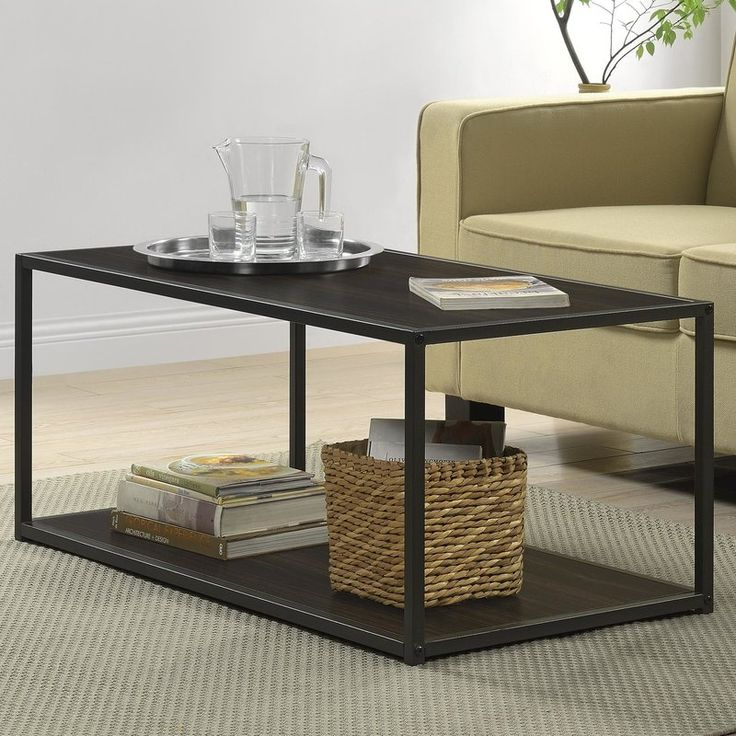 Industrial is in. Update your living room with one of the hottest looks in interior design with this sleek coffee table from Zipcode Design. Great in virtually any decor, including modern, transitional and casual spaces. This unique coffee table features a warm finish on the top, lower shelf and offset by a cool metal frame in a gunmetal gray finish. The lower shelf offers ample room for magazines, photo albums and other decorative items. Plus, the coffee table's  slim profile makes it a ...
