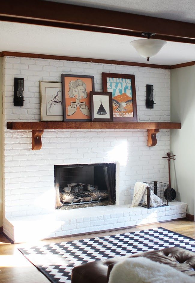 wood shelving on white brick fireplace