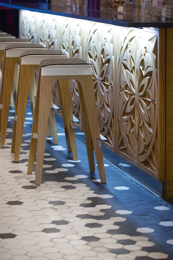 Ornate under bar detailing contrasted against an asymmetrical tile pattern and modern barstools. #bardesign #interiordesign                                                                                                                                                                                 More