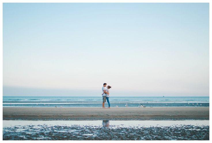 Romantic minimal portrait of a couple hugging on the beach. www.ellen-richardson-weddings.com/blog