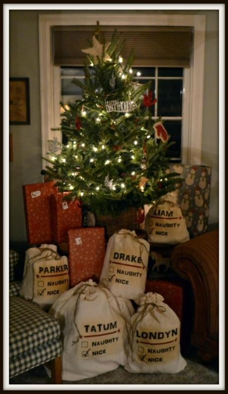 Drawstring bags with a stenciled name- gifts from Santa....totally doing this.