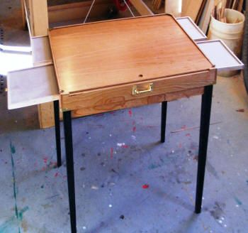 Ooh, here's a cool puzzle table that collapses!