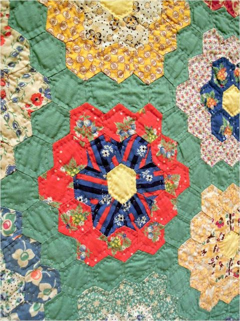 Antique 1930's Garden quilt, close up, exhibited by Lynn Kough. Quilt Inspiration: Grandmother's Flower Garden.