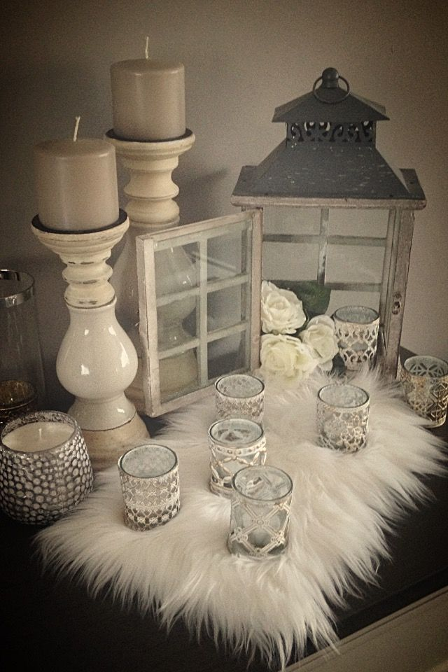 Love the white, fur and candles to accent any part of the house
