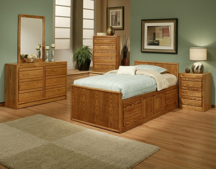 the oak designs captains bed with four storage drawers and one center cabinet is a sleeping